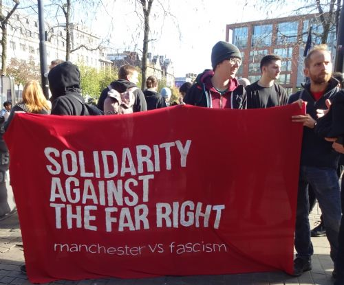 Click to view Protesters oppose EDL in Manchester