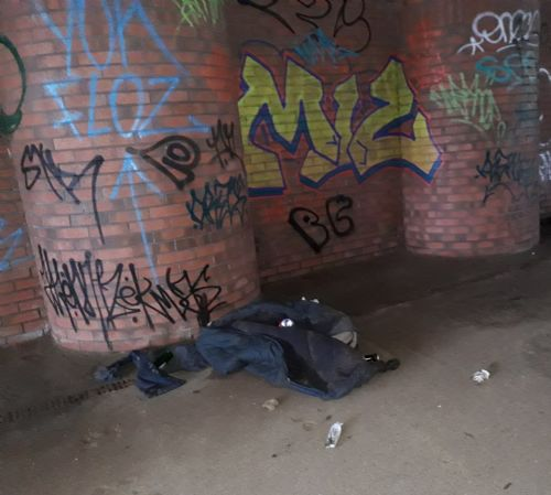 Click to view Salford homeless sleep under the bridge