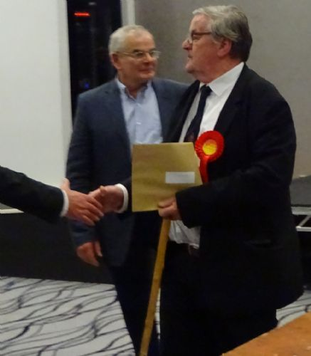 Click to view Salford Councillor David Lancaster receives his brown envelope on being re-elected
